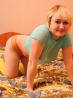 Overweight teen in yellow stockings gets all naked